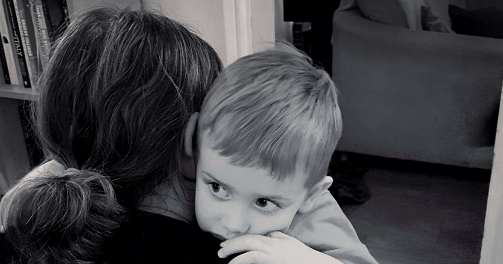 Boy hugging his mother. Photo by Someone's Mum
