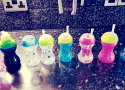 several very similar cups all lined up. Feature for viral autism piece.