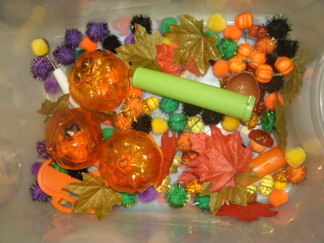 Fall Sensory Bin pumpkins acorns leaves pom poms