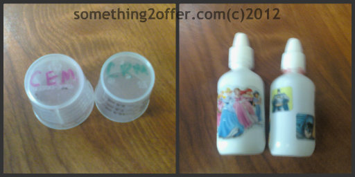 medicine cups and nose drops labeled