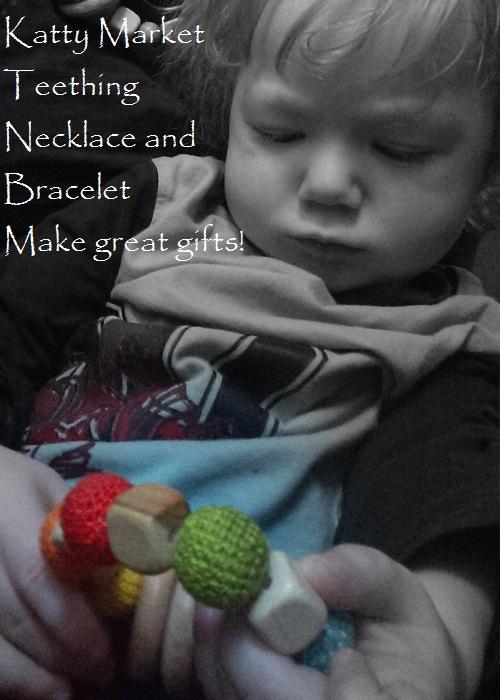 rainbow teething necklace baby hand focused