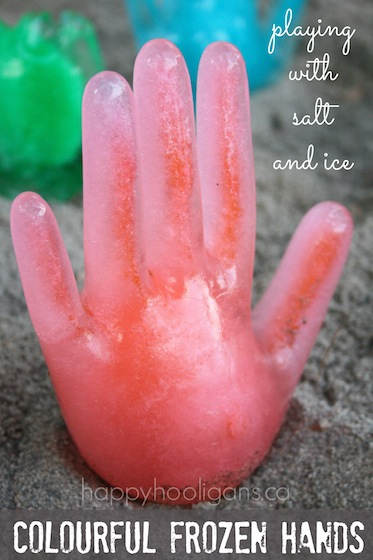 Colourful-frozen-hands-playing-with-salt-and-ice