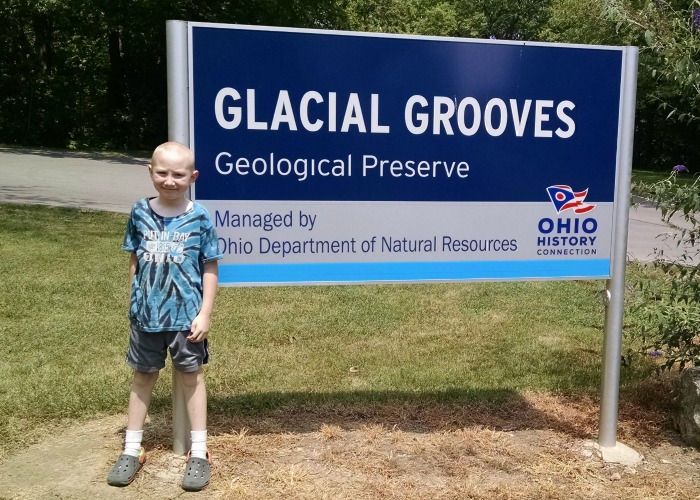 Glacial Grooves sign with Big Red