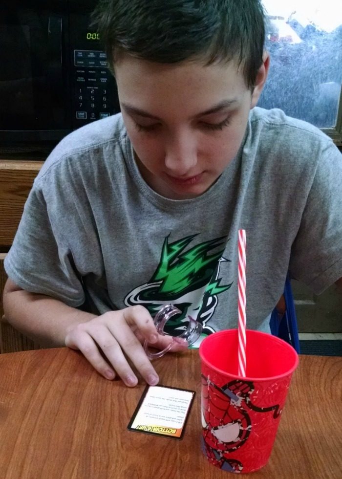 Eldest prepping for Watch Ya' Mouth straw challenge