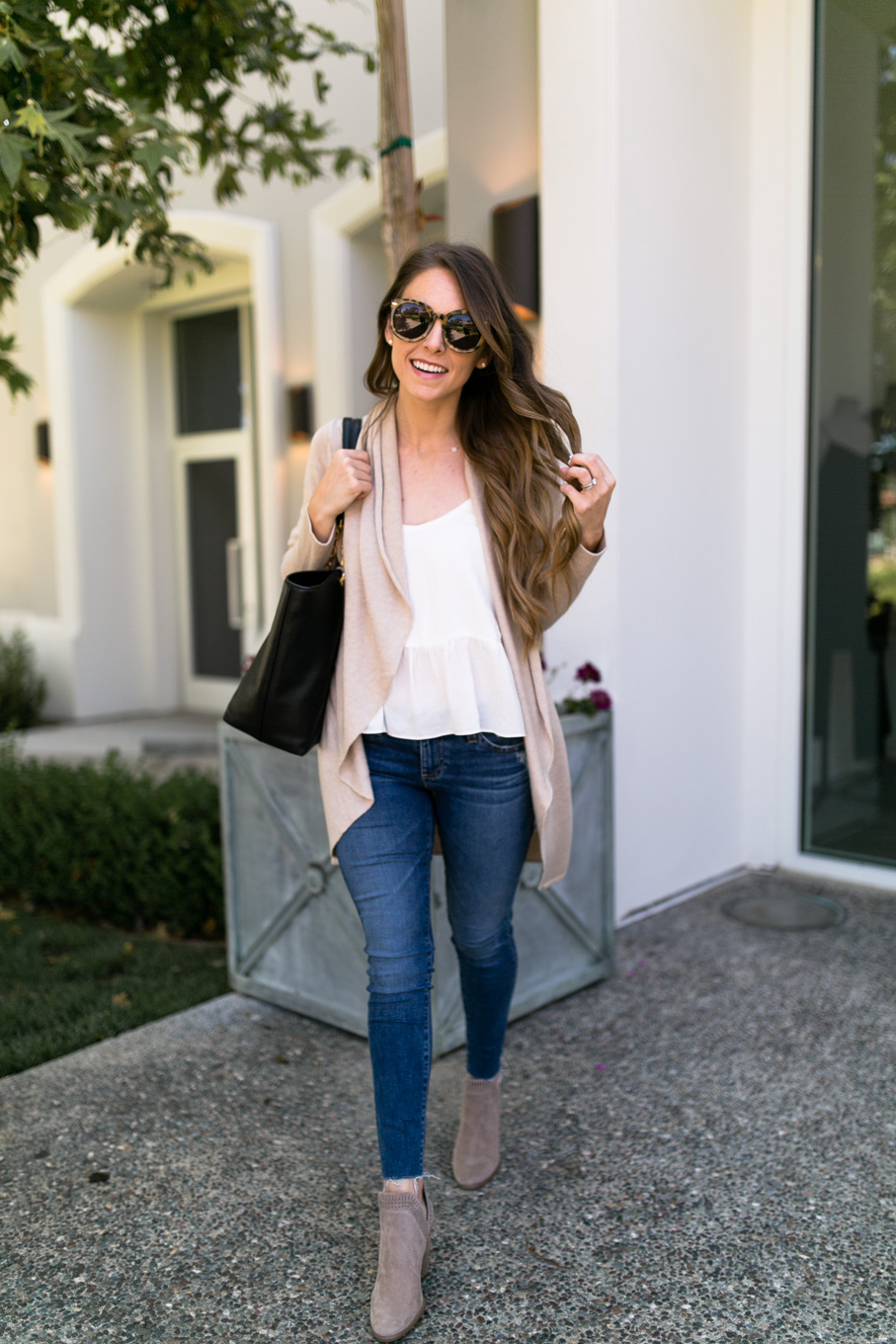 Daryl-Ann Denner wears Leith Easy Circle Cardigan from the Nordstrom Anniversary Sale 2017 with AG Skinny Jeans and Vince Camuto Booties