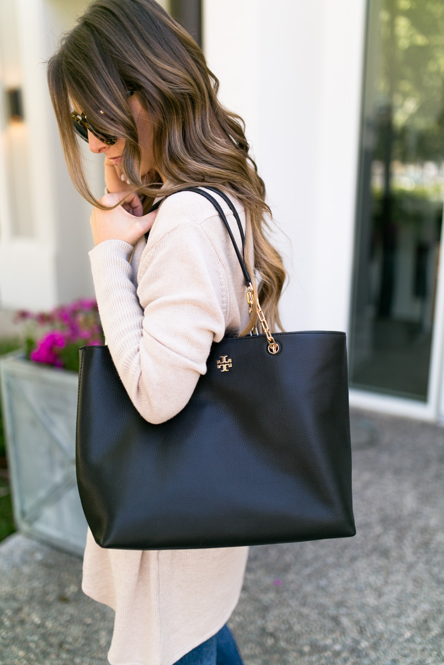 Daryl-Ann Denner wears Tory Burch Frida pebbled tote in black from Nordstrom Anniversary Sale 2017