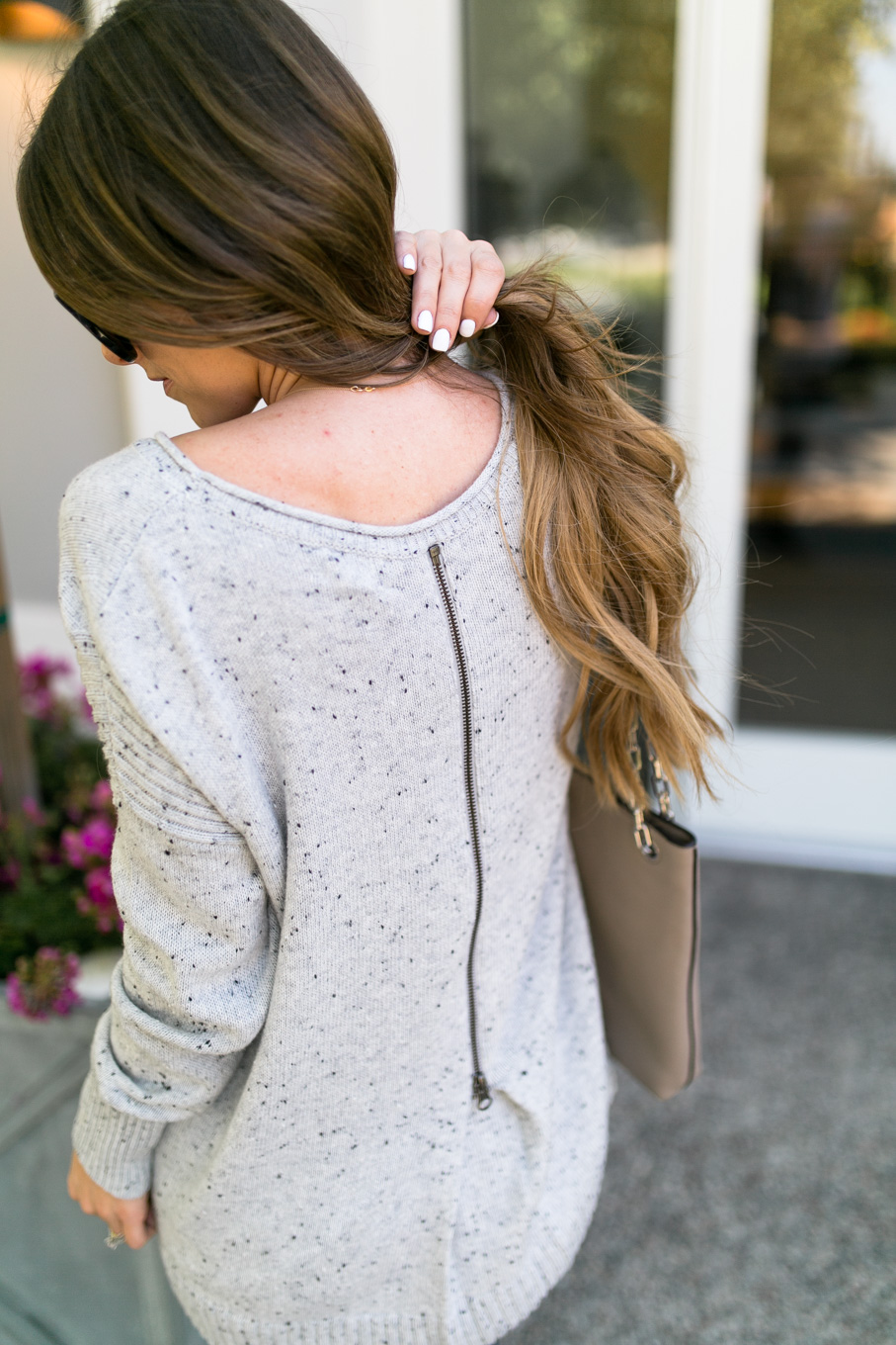 Daryl-Ann Denner wears oversized zip-back pullover sweater from nordstrom anniversary sale 2017 with ag skinny jeans and booties