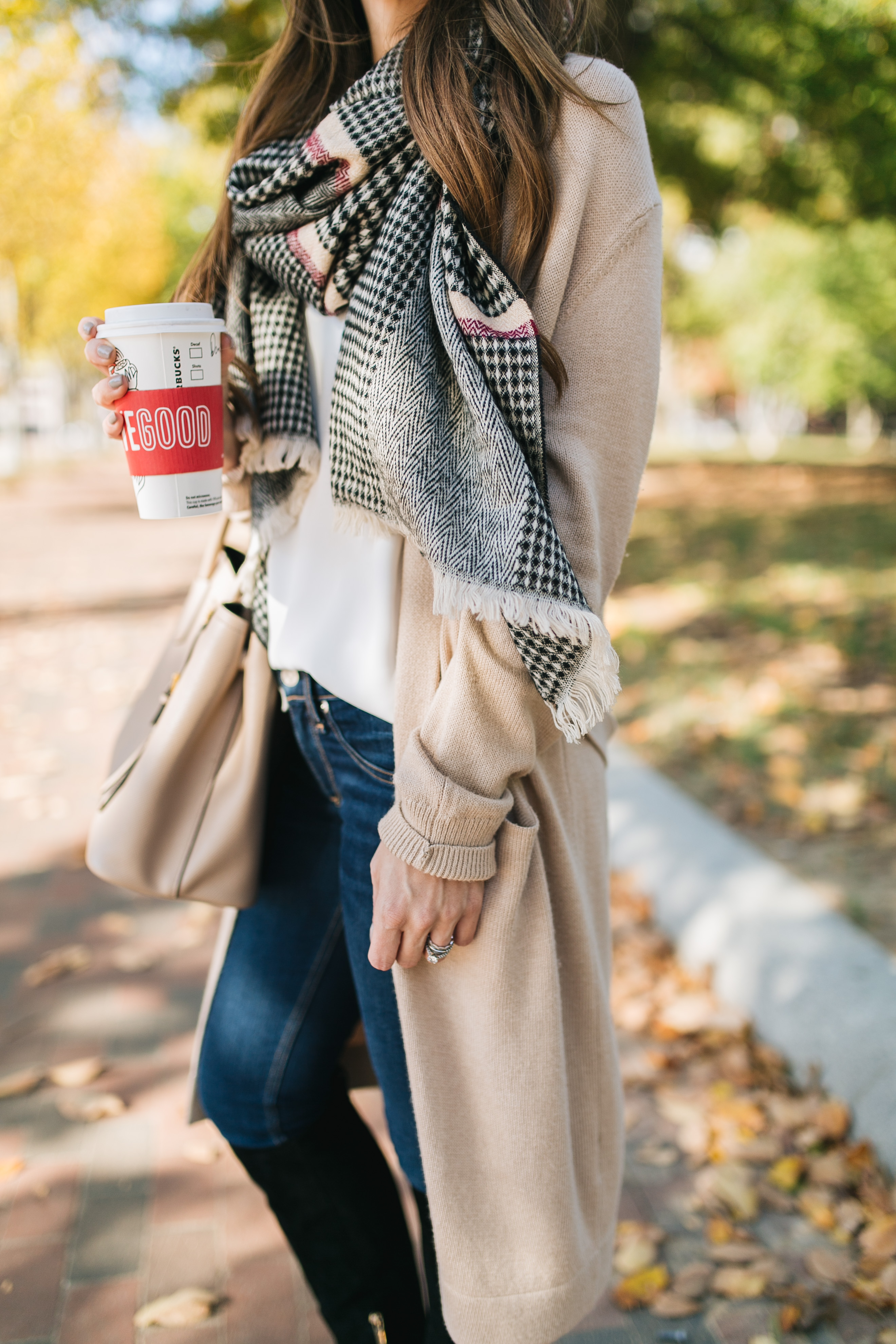 Fashion blogger Daryl-Ann Denner shares Burberry scarf dupe under $30 and a fall outfit with neutral cardigan and black suede boots