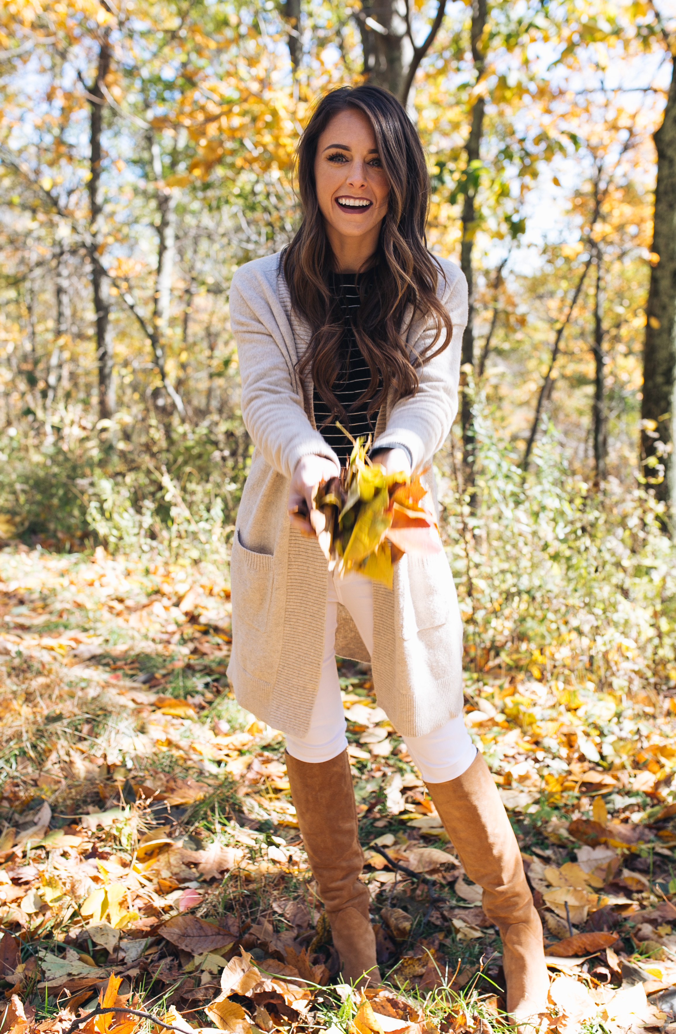 Style blogger Daryl-Ann Denner shares basic fall layering pieces under $100 including striped tees and cardigans with white jeans