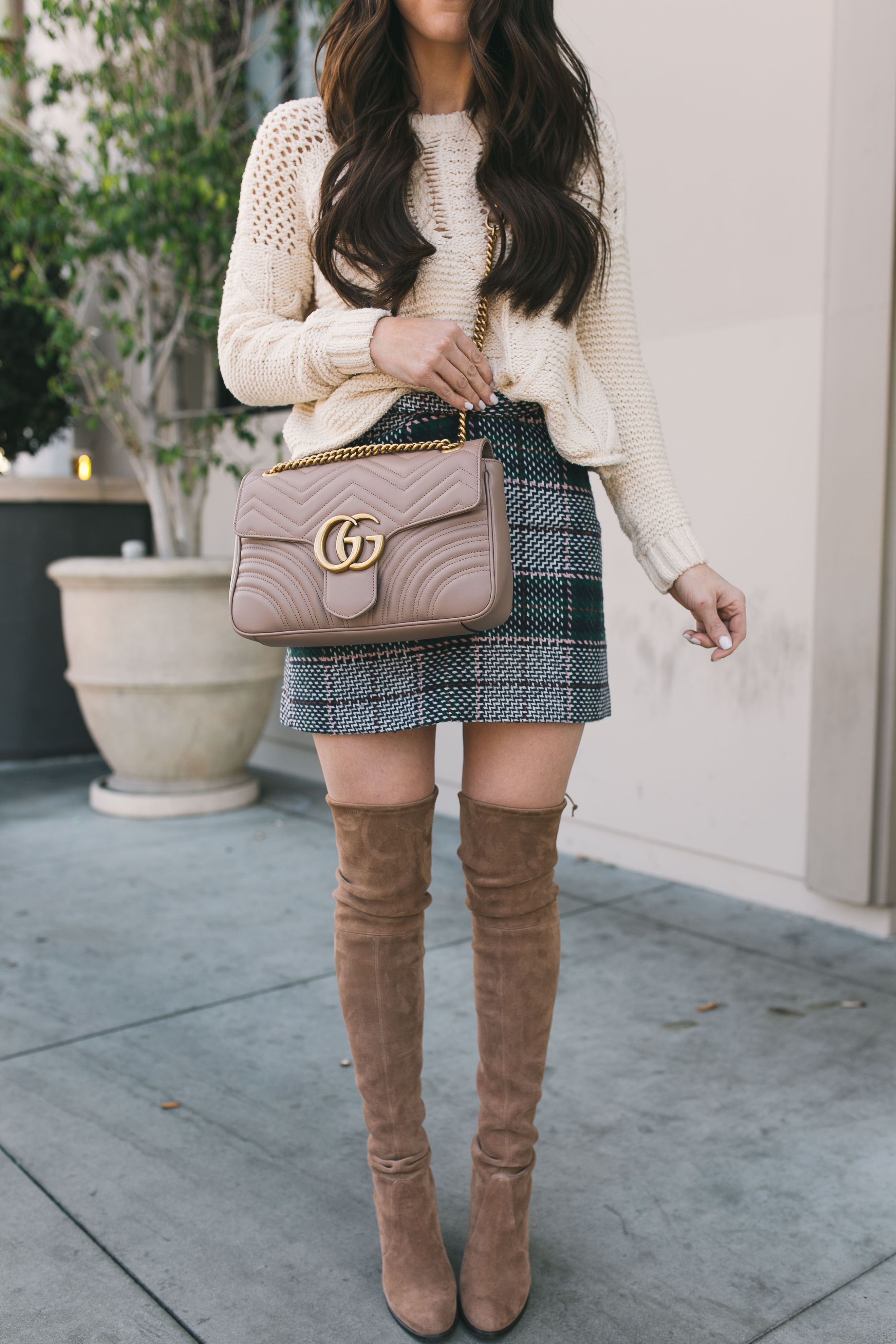 Fashion Blogger Daryl-Ann Denner shares how to wear over-the-knee boots with skirts and jeans with a gucci marmont bag