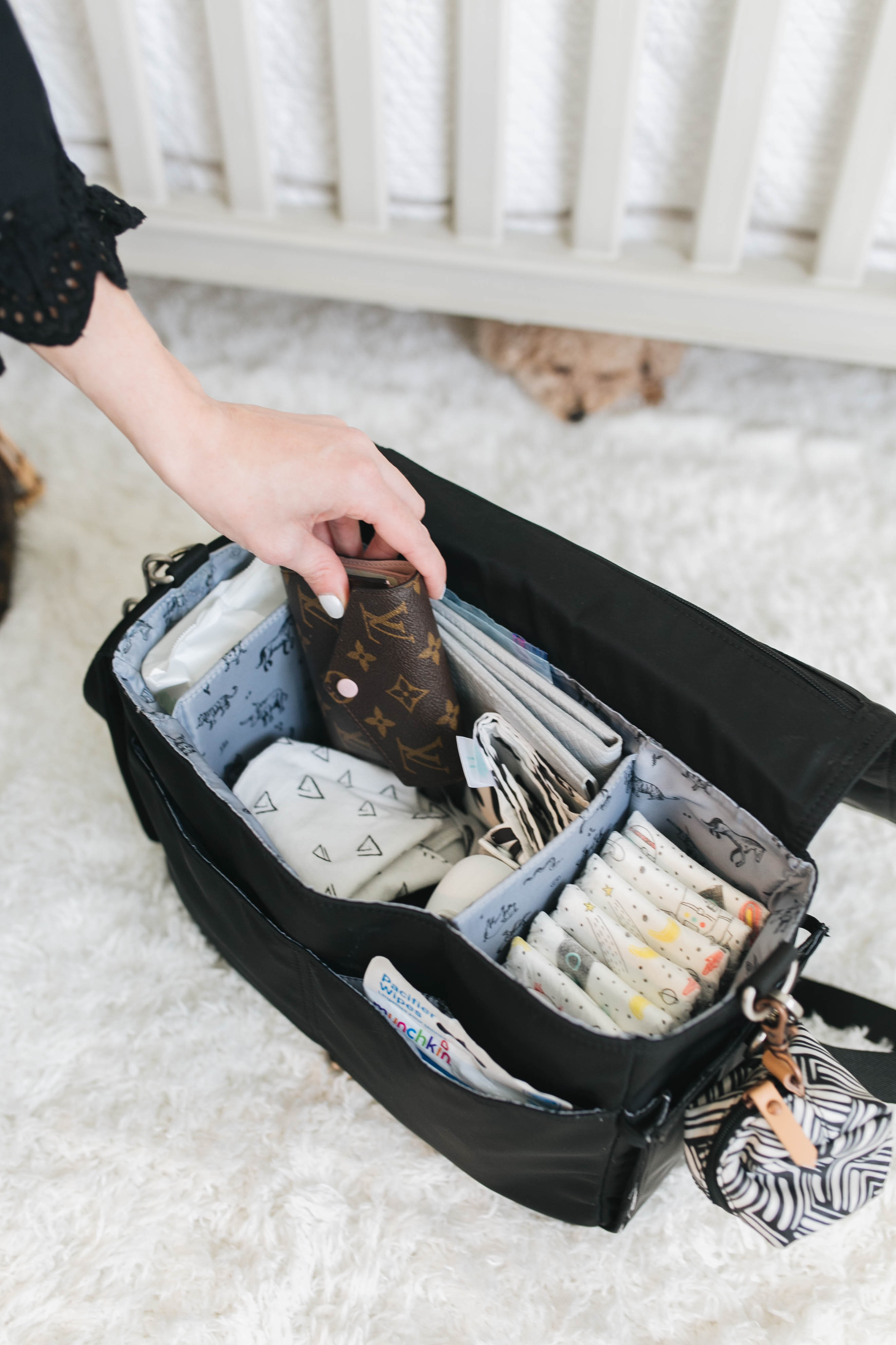 53c95eabc4ba The TwelveLittle Stroller caddy is easily my favorite because of just how  functional and simple it is. It is a structured bag that has plenty of room  for ...