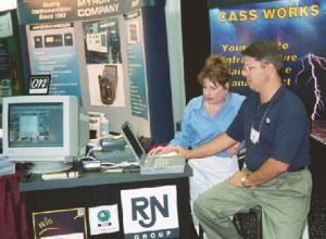 J.R. Atkins working Tradeshow Booth for RJN Group