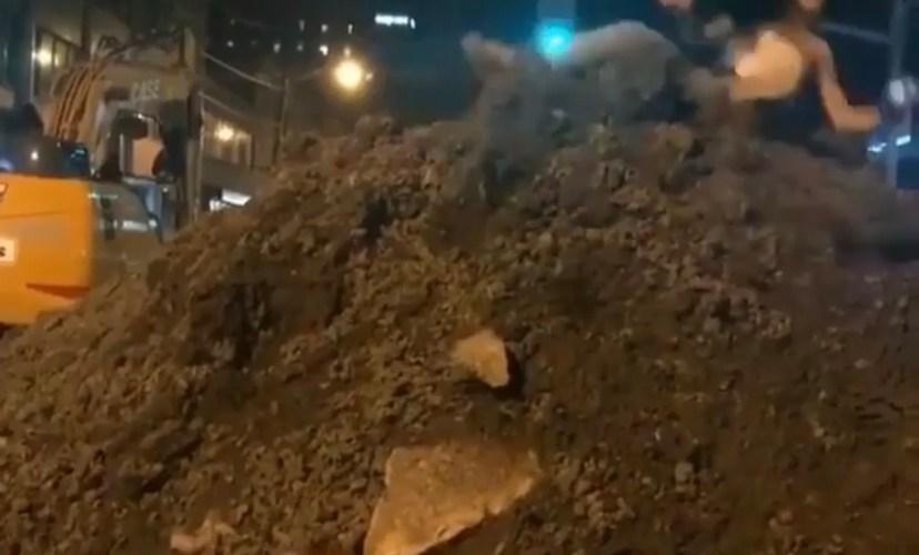 Woman falls off dirt pile