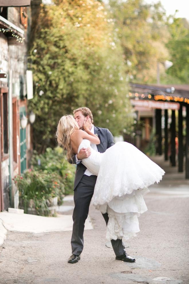 Groom lifting and kissing his bride!