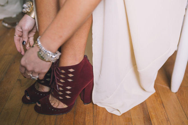 The bride putting on her shoes
