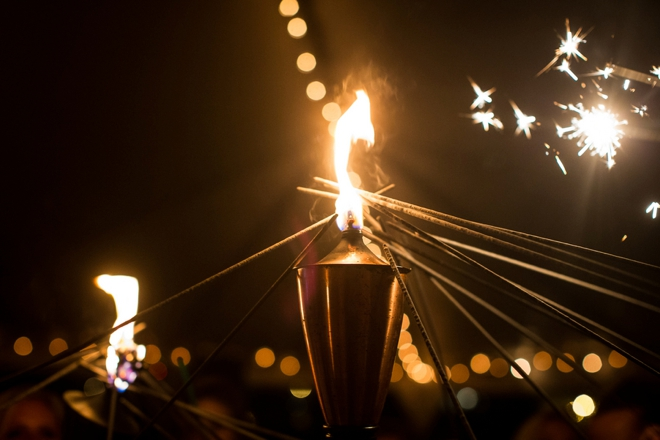 Sparklers being lit by a torch