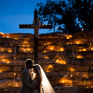 Bride and Groom in front of cross