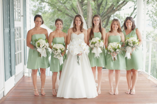 Beautiful bride and her pastel green bridesmaids