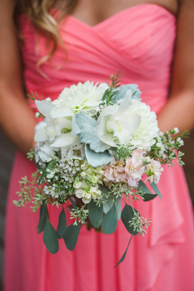 Beautiful pink bridesmaid dress and green bouquet
