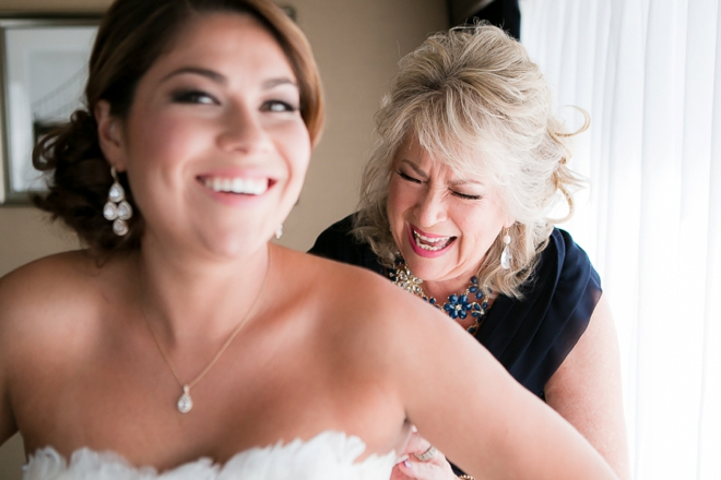 Mother zipping up the gown