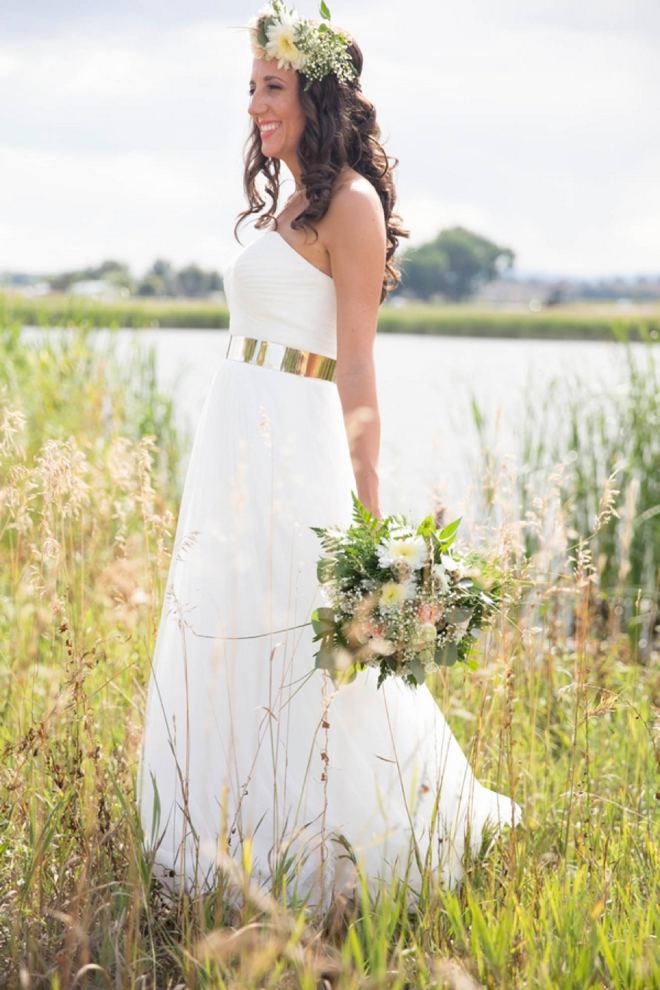 Gorgeous bride with a stunning gold belt