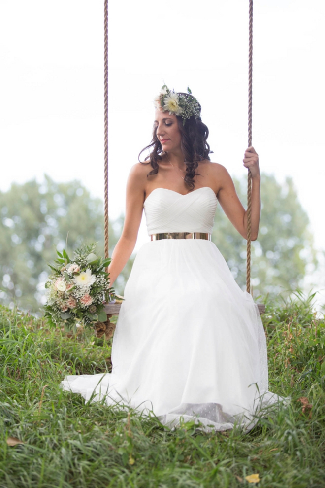 Gorgeous bride on a swing