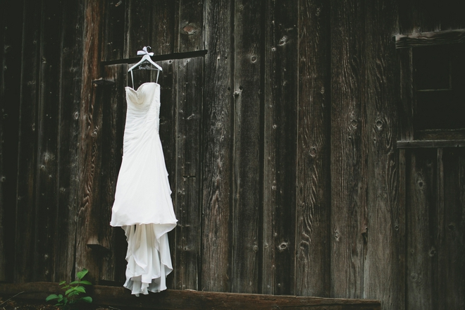 wedding dress hanging on barn