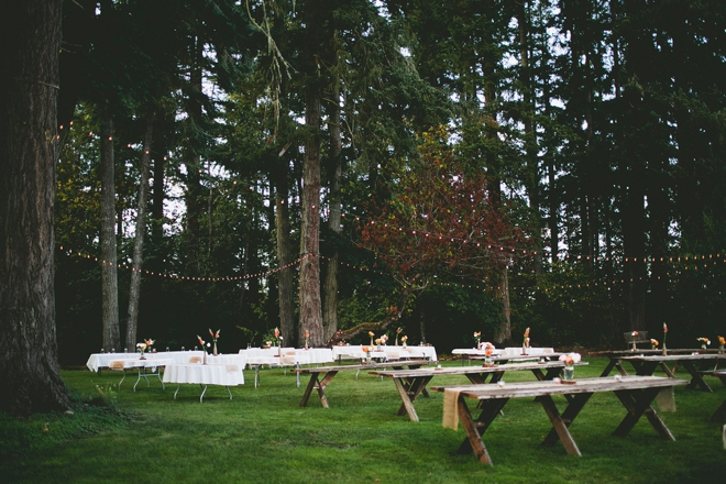 Rustic outdoor reception with wooden tables