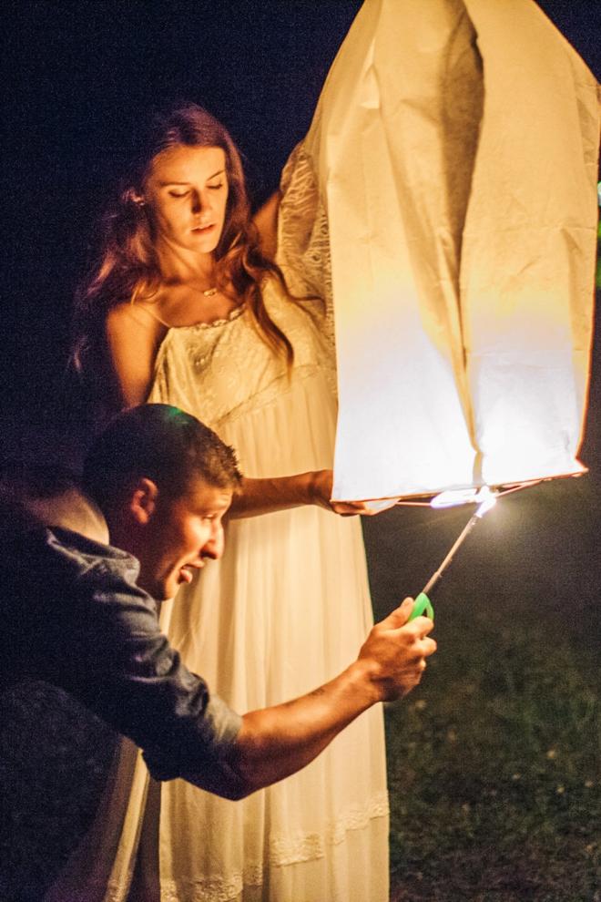 Lighting paper lanterns at the reception