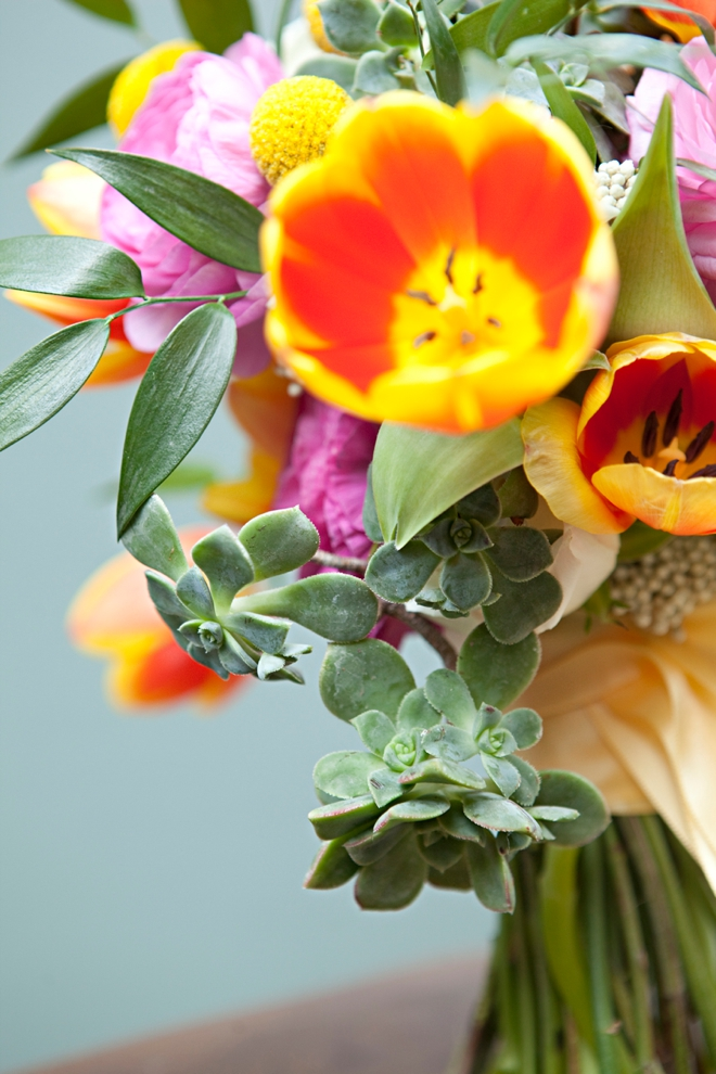 Gorgeous, garden inspired DIY wedding bouquet with tulips, ranunculus and succulents