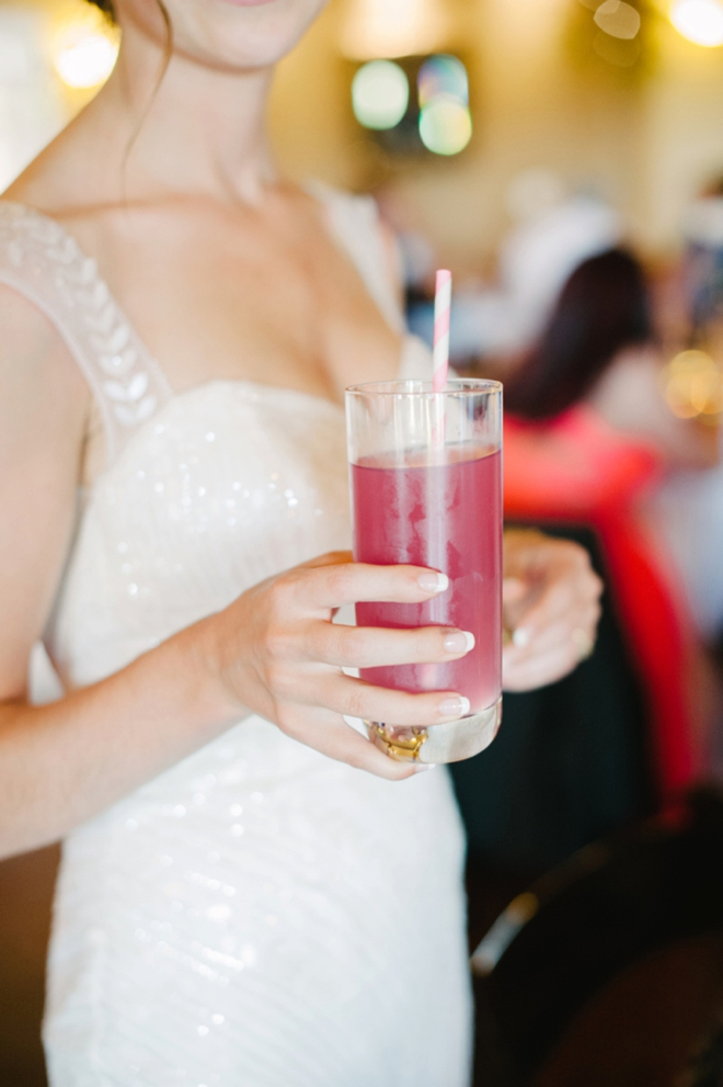 Bride with pink wedding cocktail