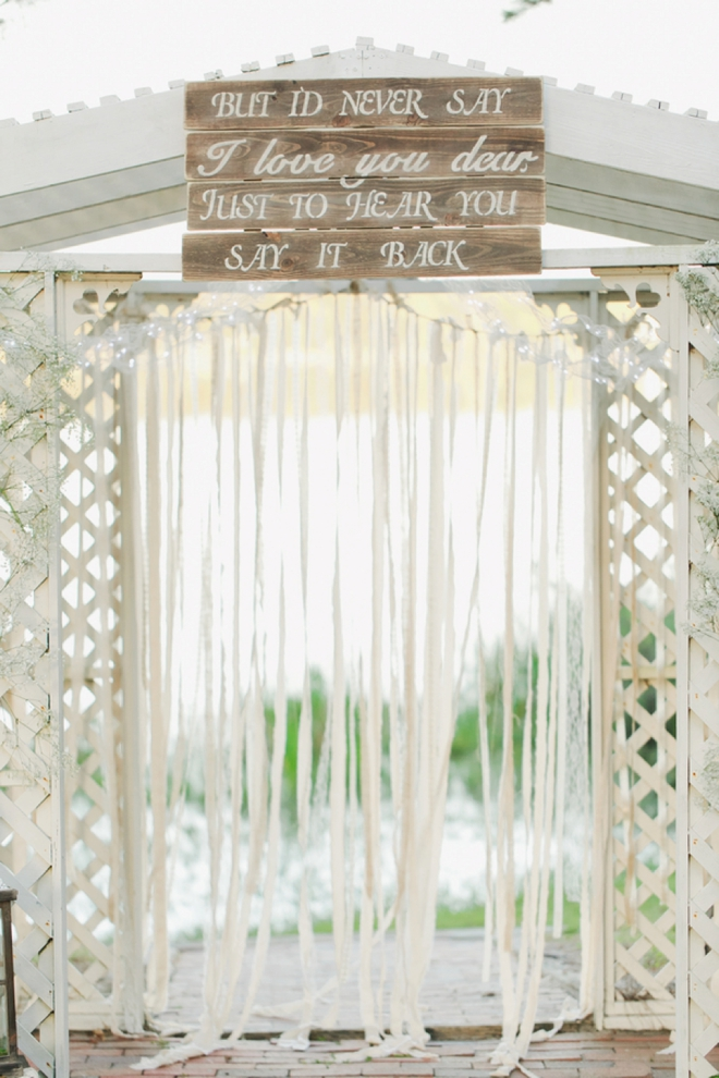 Ceremony backdrop with hand-painted sign