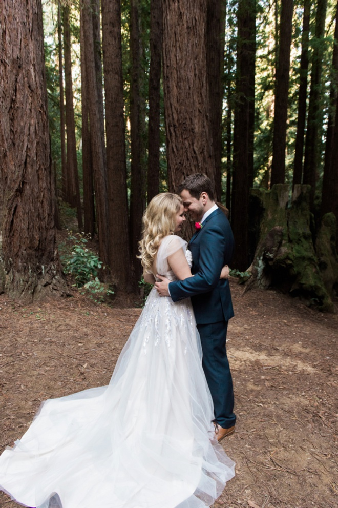 Gorgeous shot of the bride and groom in the forest!
