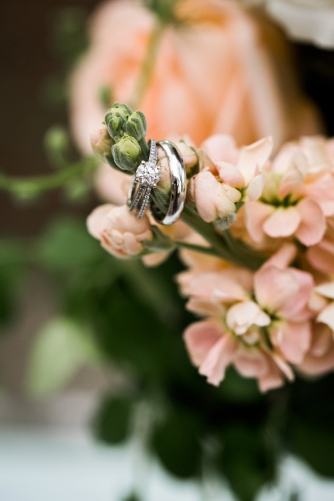 Gorgeous wedding ring shot on bouquet flowers