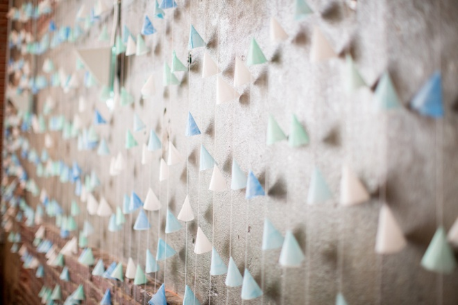 Awesome DIY colorful cone backdrop for wedding reception.