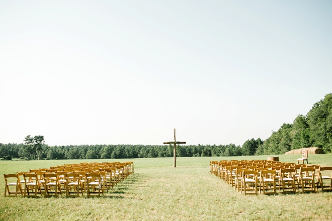 Stunning backyard wedding in front of a large handcrafted cross