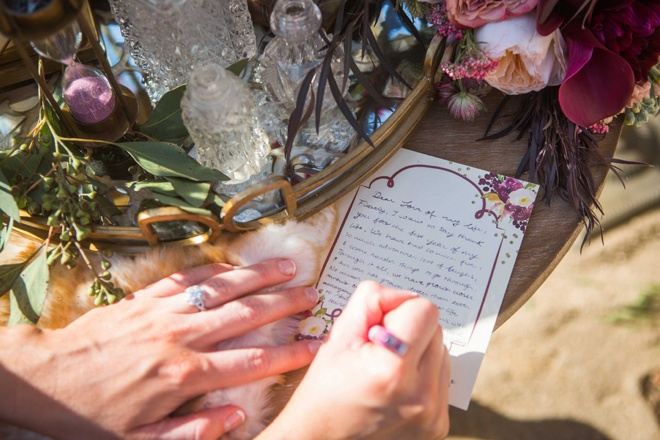 Bride writing a note to her groom