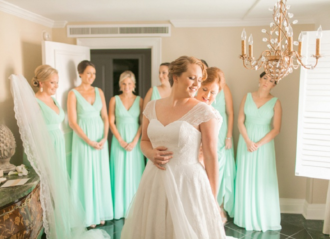 We love this shot of this gorgeous bride getting ready with her bridesmaids.