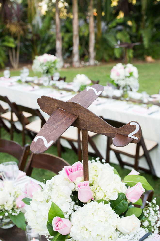 We're loving these adorable wooden airplane decor at this wedding!