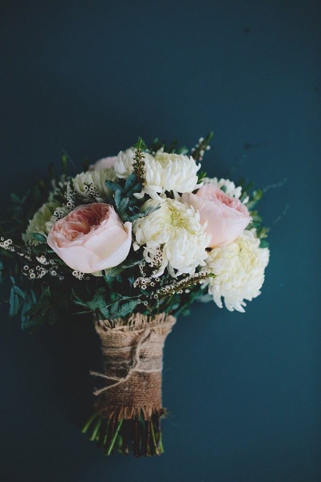 We're loving this beautiful wedding bouquet with burlap wrap!