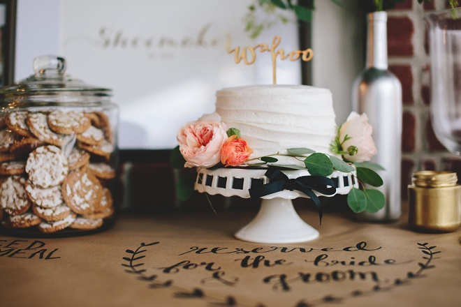 Love this gorgeous cut cake with wooden cake topper and cookie bar!
