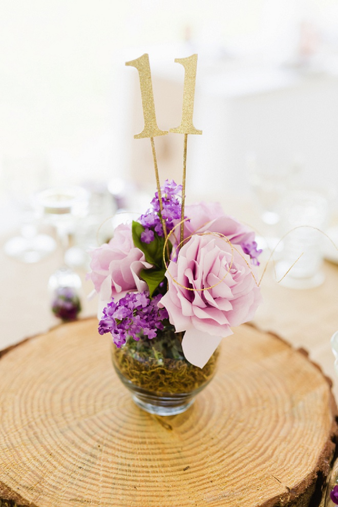 We love these gorgeous centerpices at this DIY wedding!