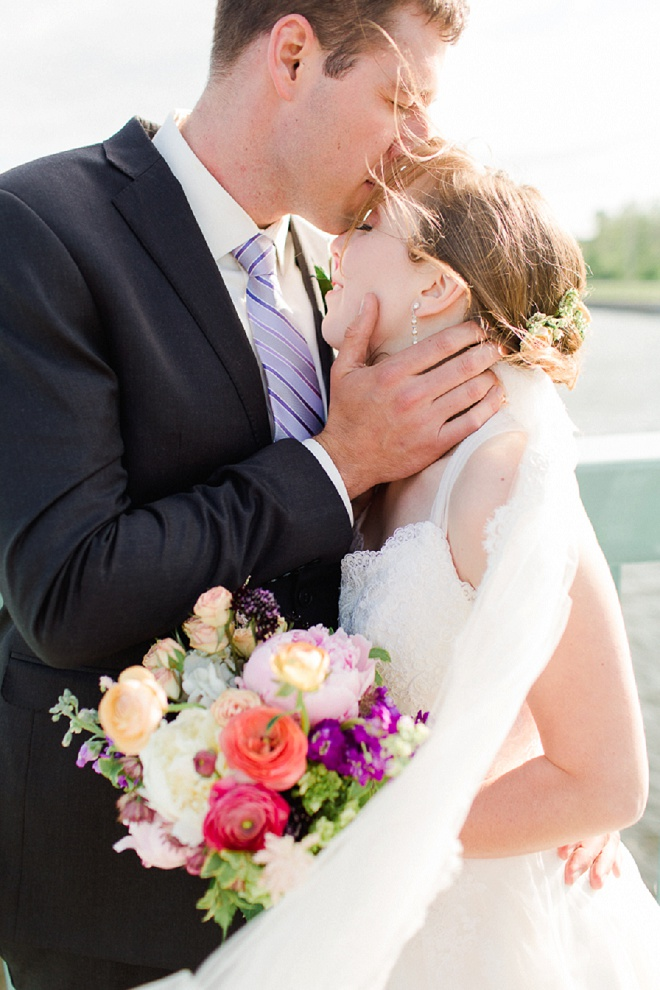 How darling is this Bride and Groom?! We're loving her bright, spring bouquet!