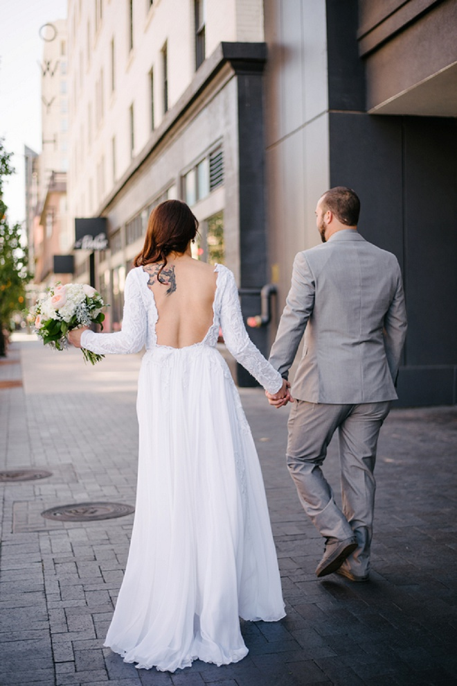 We're swooning over this first look and the Bride's long sleeve dress!
