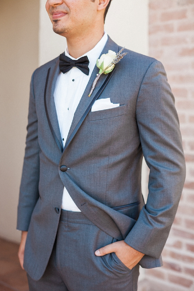 We're loving this handsome Groom's wedding style and bow tie!