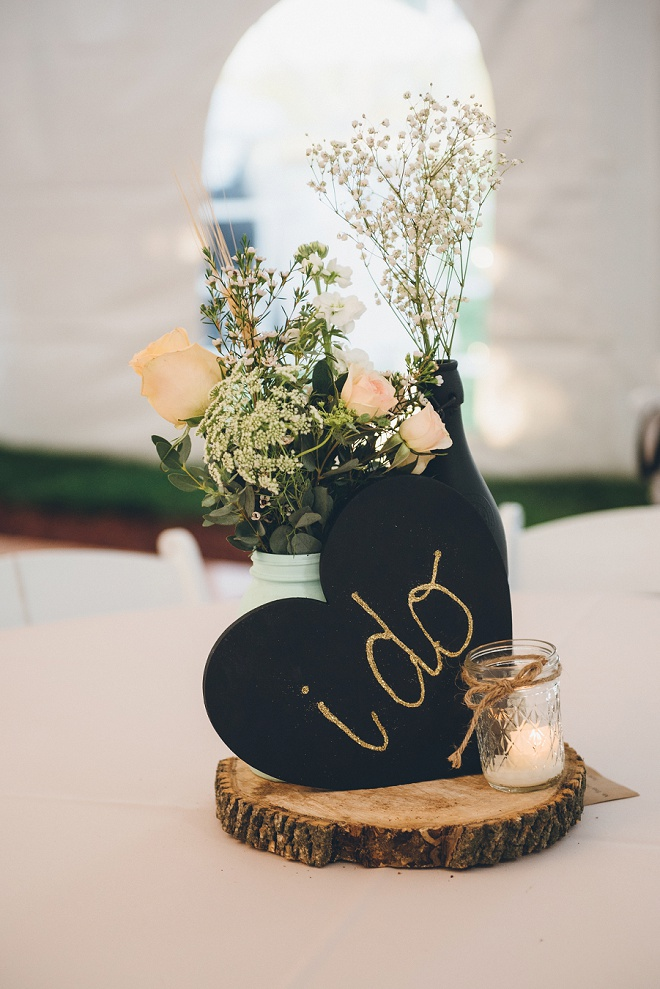 Loving the wood and chalkboard centerpieces at this gorgeous barn wedding!