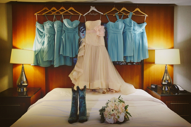 We're loving this Bride's fun blush dress and cowgirl boots for her barn wedding!