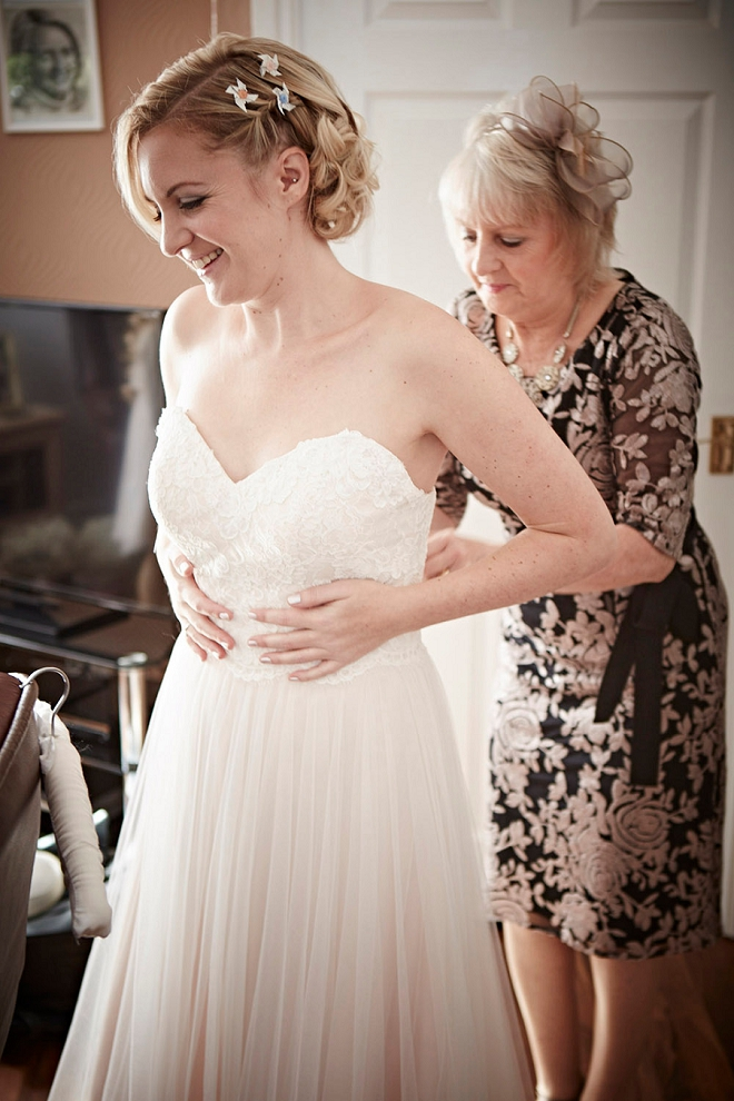 Loving this gorgeous Bride's getting ready photos in her blush wedding dress!