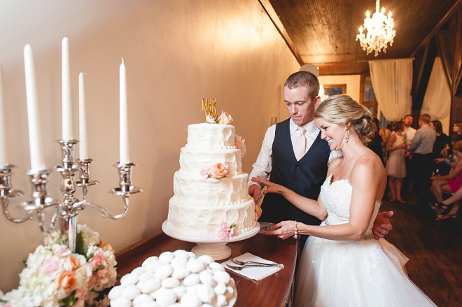 Darling cake cutting photo at this gorgeous DIY reception!