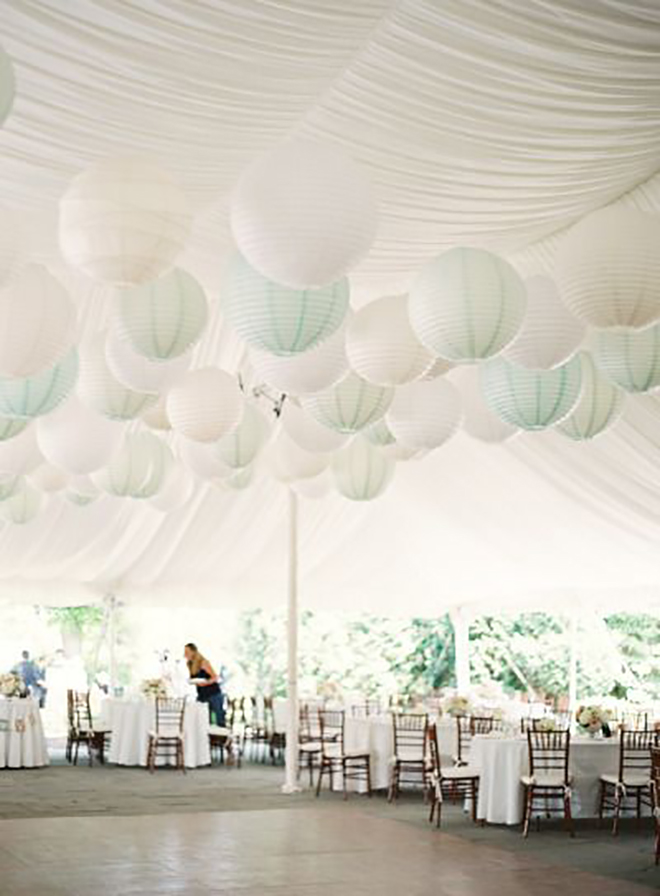 white paper lanterns against a white tent add texture and dimension